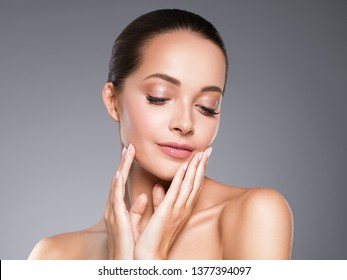Beauty skin woman face clos up healthy hair and skin cosmetic natural makeup happy model emotional face manicure nails hand