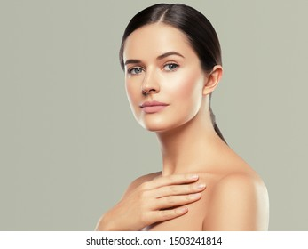 Beauty skin woman face healthy skin beautiful model close up face natural makeup brunette hair over color background