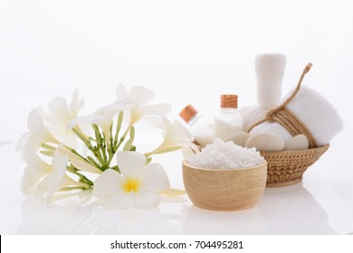 Beauty skincare and bath products  with Plumeria spa flower on white background