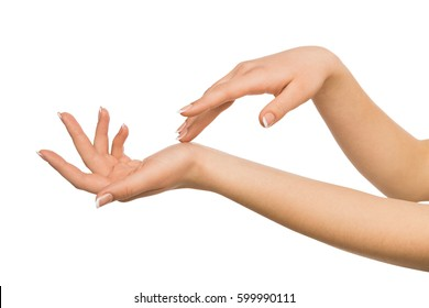 Beauty and skincare concept - beautiful female hands with french manicure, woman touching skin after spa treatment isolated on studio white background, close-up, cutout