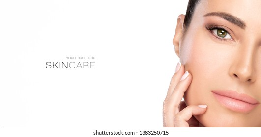 Beauty and Skincare concept. Beautiful model girl face with nude makeup on a flawless skin looking at camera with a serene expression. Closeup portrait isolated on white