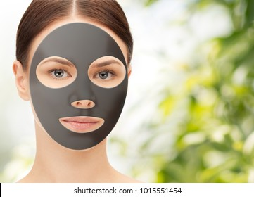 beauty, skincare and people concept - beautiful young woman with hydrogel mask on face over green natural background