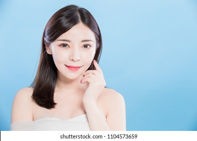 beauty skincare woman look you and smile happily on the blue background