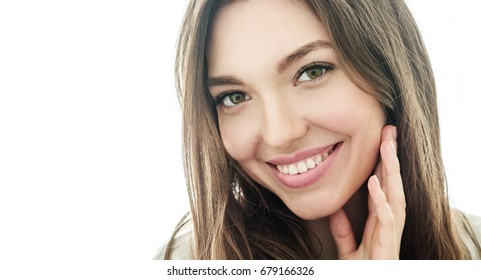 Beauty smiling model with natural make up and long eyelashes. Youth and  skin care concept. Spa and wellness. Make up, long hair and lashes. Close up, selective focus.