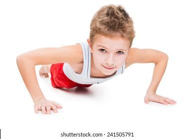 Beauty smiling sport child boy press up exercising white isolated