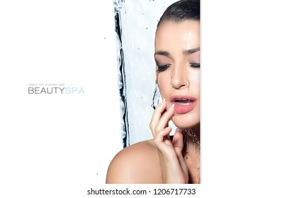 Beauty spa concept with a gorgeous brunette woman under stream of water. Portrait of beautiful sensual young woman with white background and copy space
