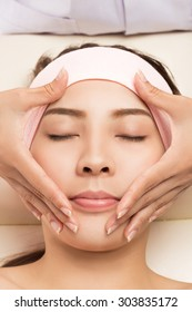 Beauty and Spa - massage of face for woman in spa salon, enjoying a facial massage.