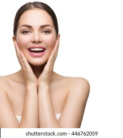 Beauty Spa Woman with perfect skin Portrait. Beautiful Brunette Girl looking at camera, touching her skin and smiling. Happy female pampering her skin, treatment. Isolated on white background