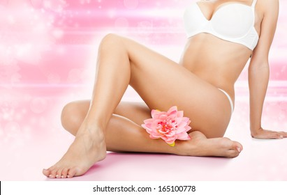 beauty spa women legs wax, body bikini, depilation skin health care concept of waxing over abstract flower background