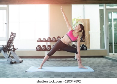 beauty sport woman smile and do yoga in the gym