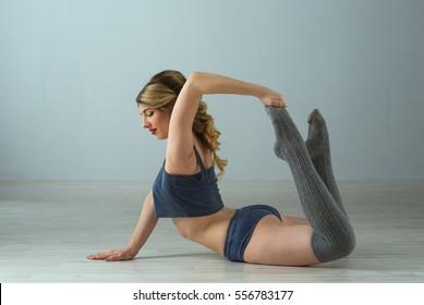 beauty sport woman training on gray background