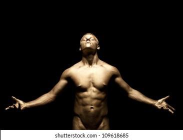 Beauty strong man stand under light