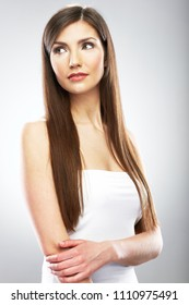 Beauty style portrait of young woman with long hair. Isolated studio.