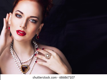 beauty stylish redhead woman with hairstyle and manicure wearing