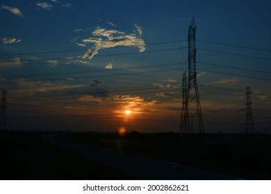 The beauty of the sunset in the afternoon combined with the electric tower.