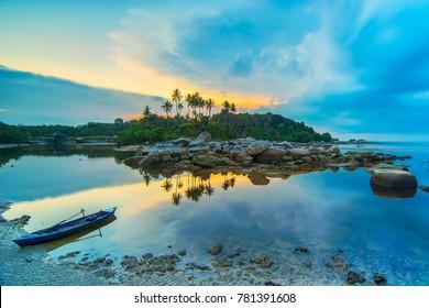 Beauty sunset and boat fishermen village bintan island