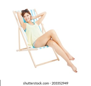 beauty sunshine girl smiling and lying on a beach chair