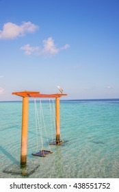 Beauty Swing on clean and clear water at the Maldives Beach, Maldives Island, Resort and Blue sky, Swing Beautiful Sun Sea Sand and Sky in Maldives