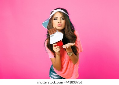 Beauty teen model girl eating dark chocolate. Beautiful Surprised young woman takes chocolate sweets,smiling and having fun. Funny girl, professional make up and bow hairstyle.