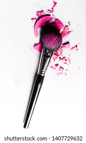 Beauty texture, cosmetic product and art of make-up concept - Brush with crushed eyeshadow and powder close-up isolated on white background