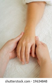 Beauty therapist hands massaging hands or manicure