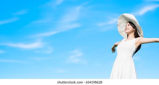 beauty travle woman feel free with blue sky