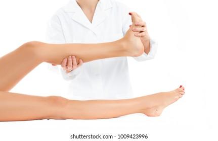 Beauty treatment concept. Beautiful woman having massage leg at spa salon