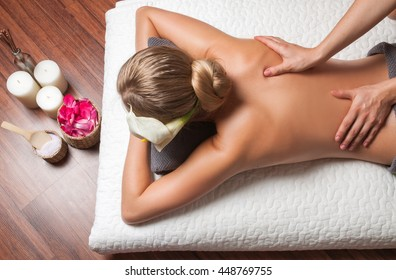 Beauty treatment concept. Beautiful young woman having massage with  in spa salon