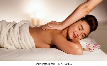Beauty treatment concept. Masseur doing massage on woman body in spa salon