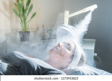 Beauty treatment of face with ozone facial steamer in beauty center. Beaultiful Blonde Girl. - Shutterstock ID 1373953823