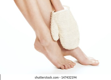 Beauty treatment for feet and legs. Hand massaging feet. Studio shot.