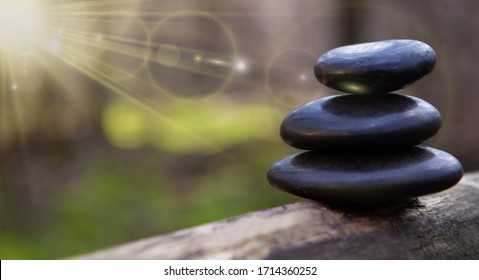 Beauty treatment and wellness background. Stacked massage stones stock photo - copy speace text.