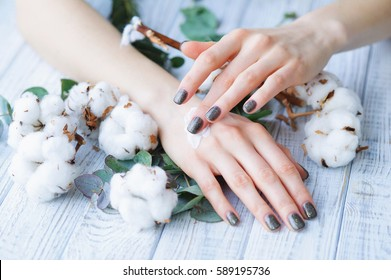 Beauty treatment for woman hands with natural moisturizing lotion