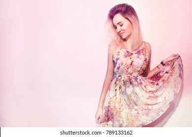 Beauty Valentine's Day Woman in dress. Fashion Model Girl face profile Portrait. Smile in pink background. Fashion pretty sweet young woman with pink lips.
