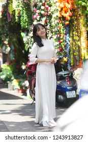 Beauty Vietnamese women wear traditional in Old town in Hanoi walking and posing with smile.The Ao dai ( long-dress Vietnamese) is traditional costume of Vietnamese woman