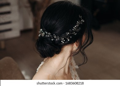 Beauty wedding hairstyle. Bride. Brunette girl with curly hair.