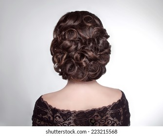 Beauty wedding hairstyle. Bride. Brunette girl with curly hair styling