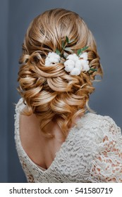 beauty wedding hairstyle decorated with cotton flower, rear view