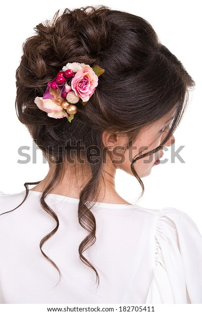 Beauty wedding hairstyle with flowers. Bride