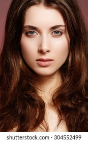 Beauty, wellness, cosmetics, spa. Beautiful woman model face with natural make-up, shiny hair, soft clean skin. Daily look