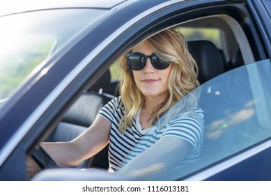 Beauty at the wheel of the car. Attractive blonde in the car.