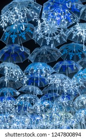 The beauty of white umbrellas iluminated by Christmas lights decorating the streets of Agueda Portugal