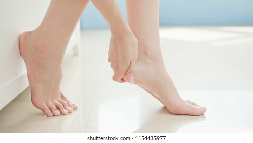 beauty woman apply cream with foot at home