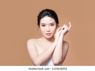 beauty woman asia and have white skin charm and brown background