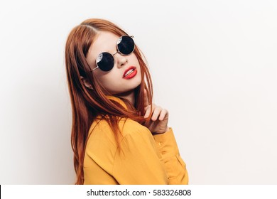 Beauty woman in black round glasses