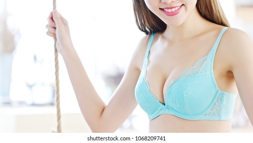 beauty woman with body chest and bra at home