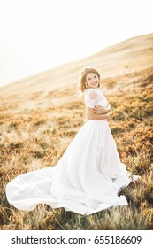 Beauty woman, bride with perfect white dress background mountains