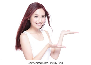Beauty woman with charming smile and show something to you with health skin, teeth and hair isolated on white background, asian beauty