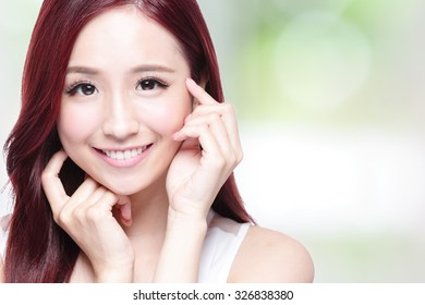 Beauty woman with charming smile to you with health skin, teeth and hair with nature green background, asian beauty