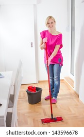Beauty woman cleaning and mopping floor at home.
